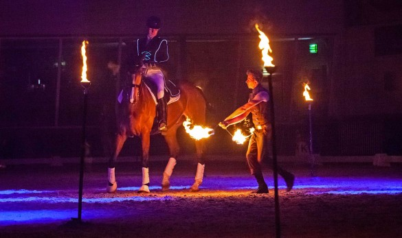Fin Jopson rides through fire to demonstrate his horse training